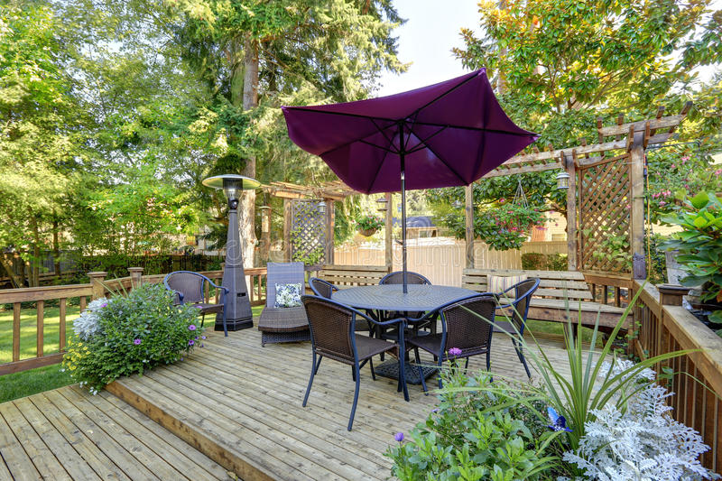 Backyard patio area with outdoor wicker furniture. Northwest, USA royalty free stock photos