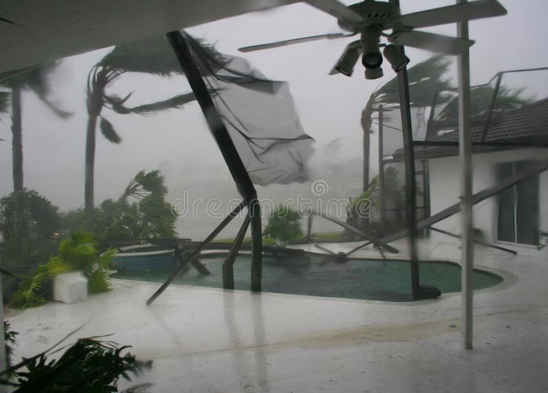 A backyard patio is ripped up from Hurricane winds. royalty free stock photos