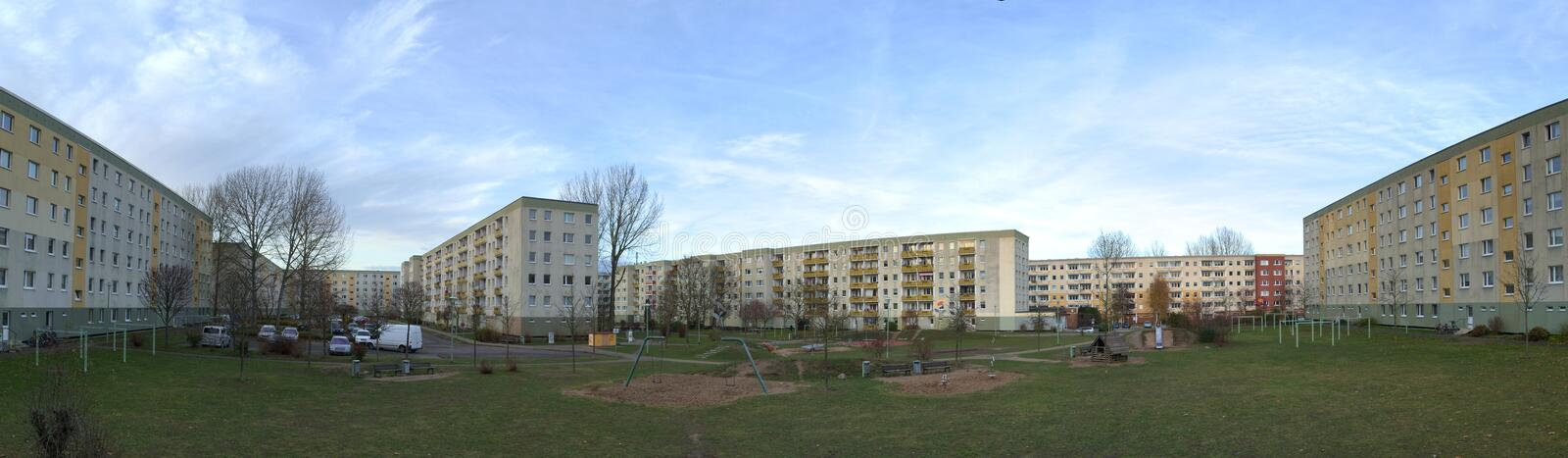 Backyard of Plattenbau complex with playground and parking lot in Greifswald, Germany.  stock image
