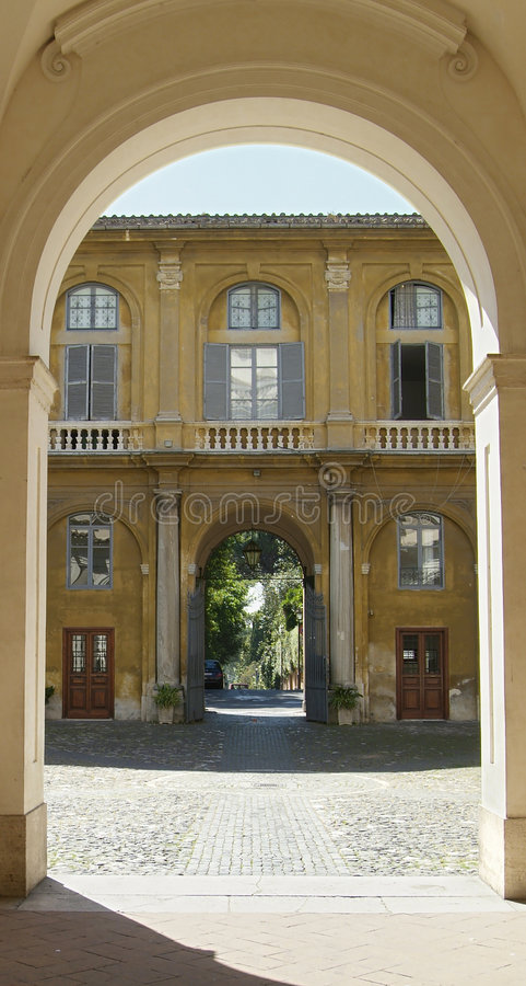 Backyard in Rome. With view to the street through the gate royalty free stock images