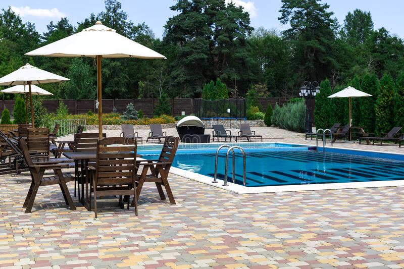 Backyard with swimming pool and patio area. royalty free stock photos