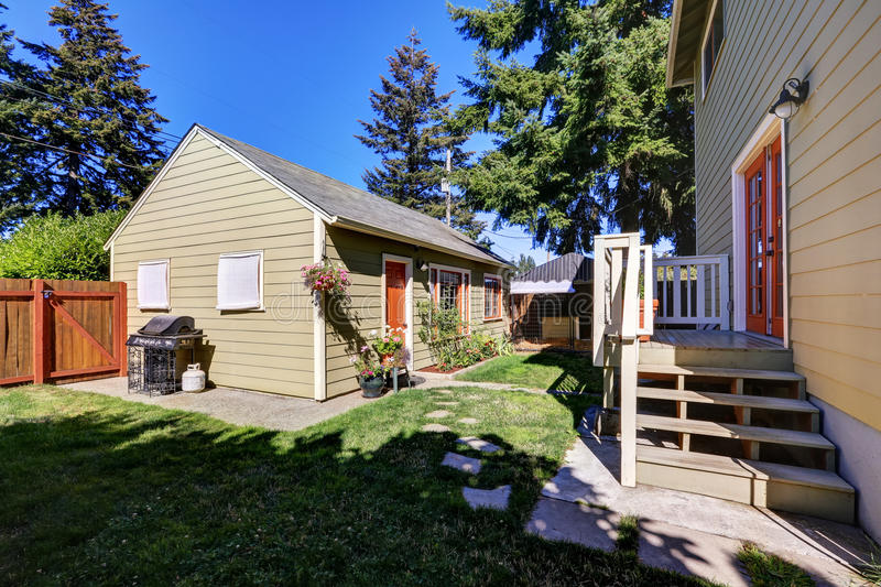 Backyard view of craftsman house with a shed stock photo