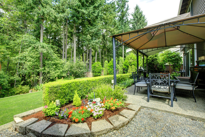 Backyrd gazebo with patio area royalty free stock photography