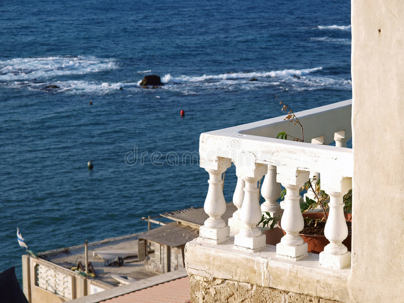 Baclony porch with view of the Mediterranean. Balcony porch terrace with view of the Mediterranean Sea royalty free stock image