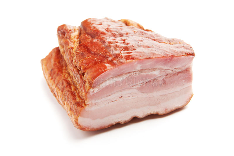 Bacon. Beautiful piece of bacon isolated on white royalty free stock image