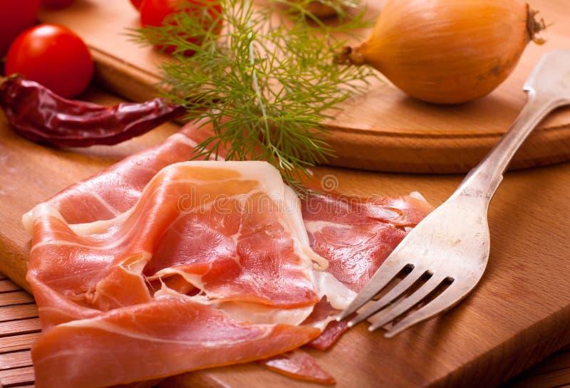 Bacon affettato immagine stock