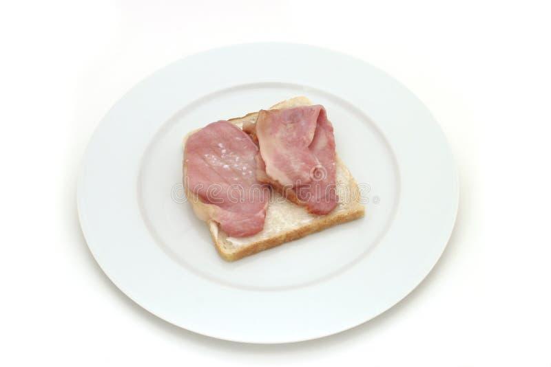 Bacon on bread stock photos