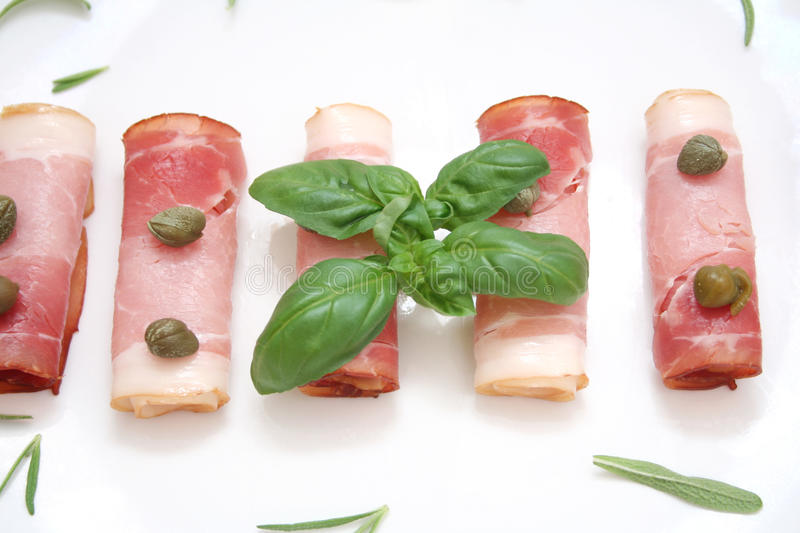 Bacon and capers. Some fresh bacon with capers and spices stock photos