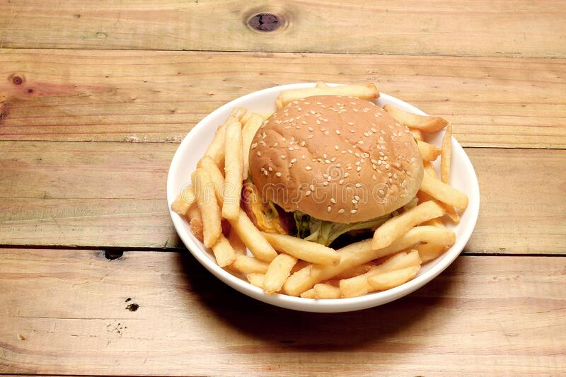 Bacon Cheese Burger and Chips royalty free stock photos
