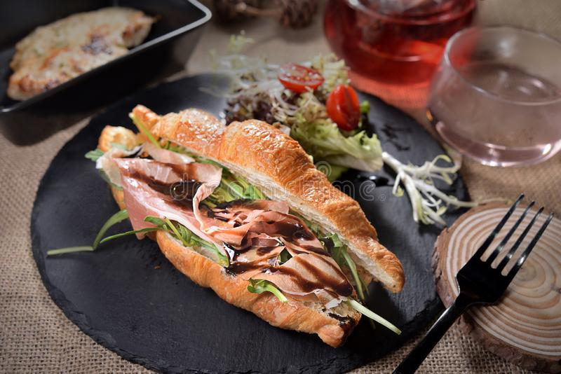 Bacon Croissant Rocket bun. Salad platter royalty free stock photo