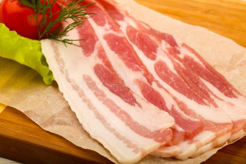 Bacon cru foto de stock