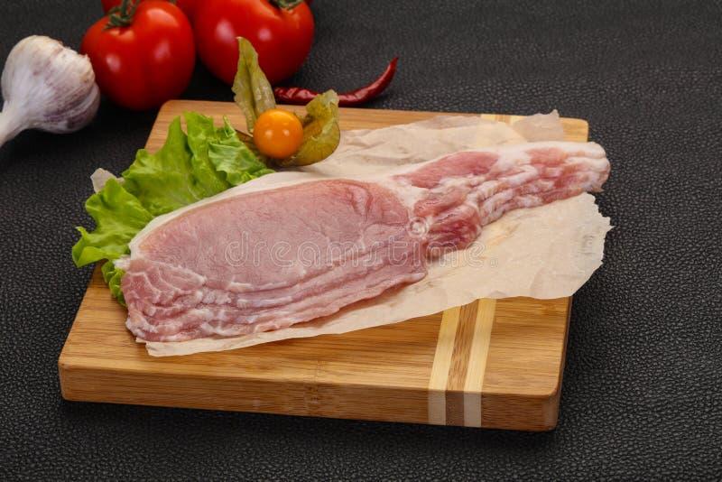 Bacon cru da carne de porco fotografia de stock