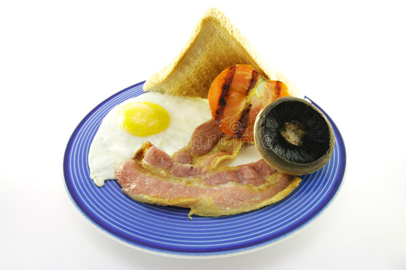 Download Bacon And Egg Breakfast On A Blue Plate Stock Photo - Image of bacon, slices: 10855016