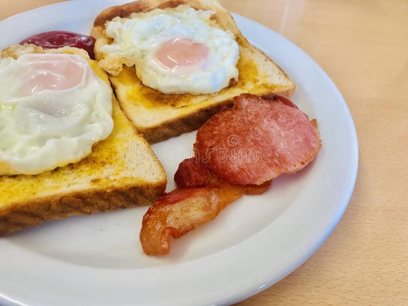Bacon and egg breakfast stock photo