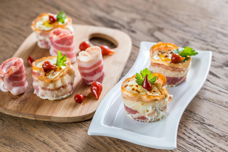 Bacon egg cups stock photography
