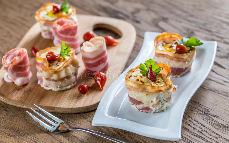 Bacon egg cups stock image