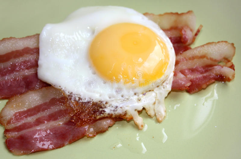 Bacon and eggs. Freshly cooked bacon and eggs stock photography