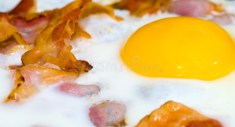 Bacon and eggs. Freshly cooked bacon and eggs royalty free stock images