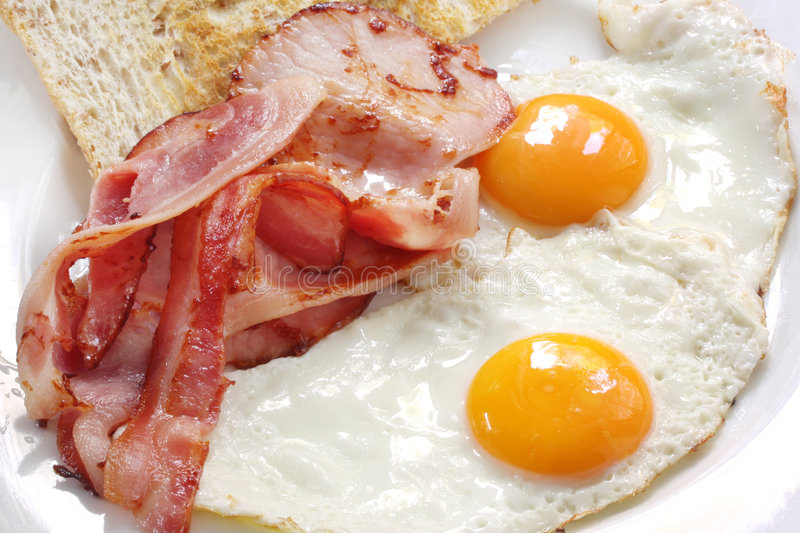 Bacon and Eggs. Breakfast of bacon and eggs with wholegrain toast. Close-up view stock photos