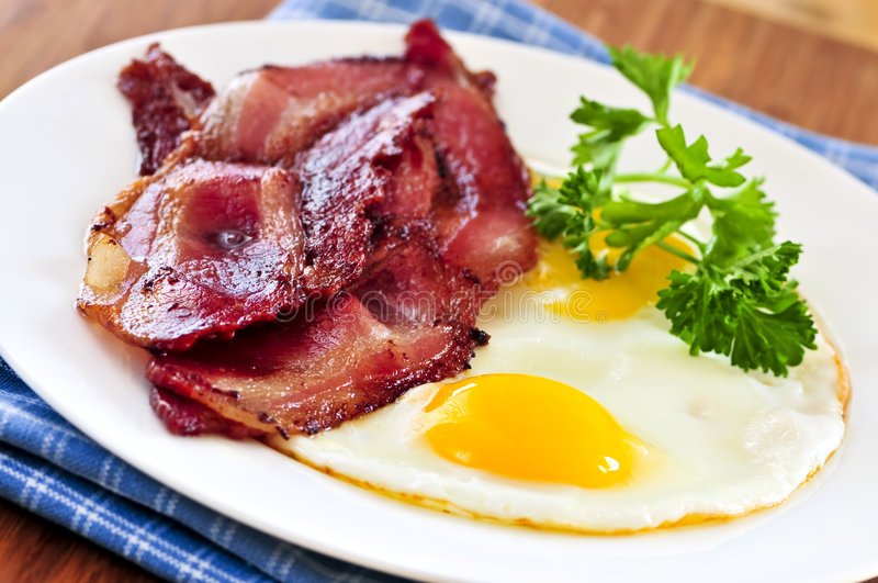 Bacon and eggs. Tasty breakfast of bacon and fried eggs royalty free stock photos