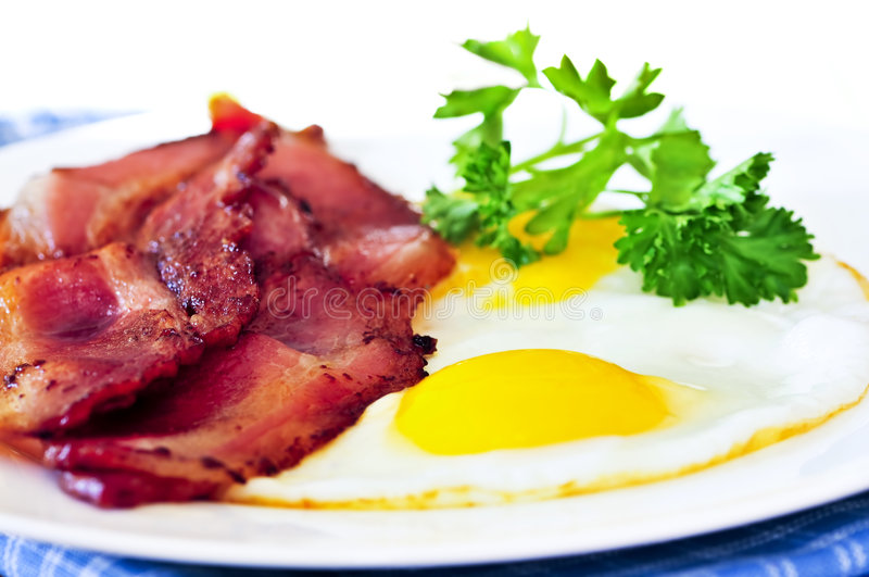 Bacon and eggs. Tasty breakfast of bacon and fried eggs royalty free stock images