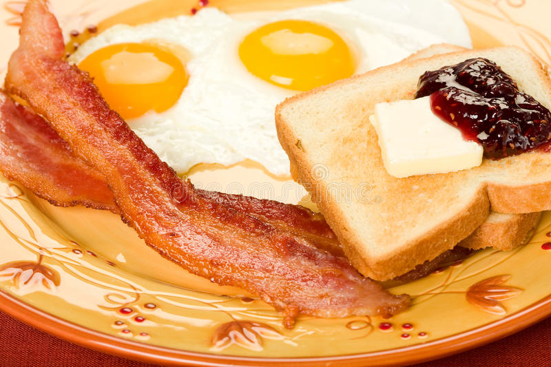 Bacon and Eggs. Along with toast and jelly for the perfect not so healthy breakfast royalty free stock images