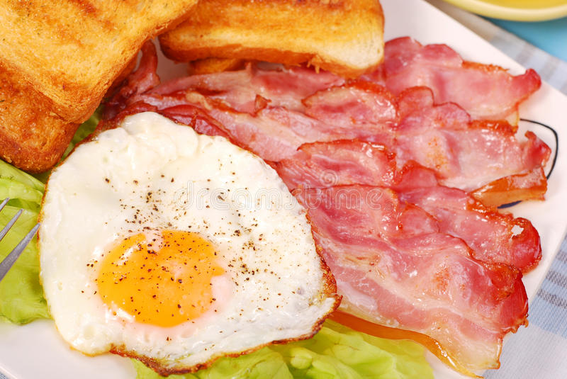 Bacon and eggs for breakfast stock photos