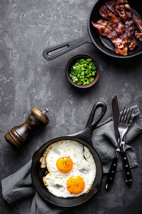 Bacon and eggs. On dark stone background royalty free stock photography