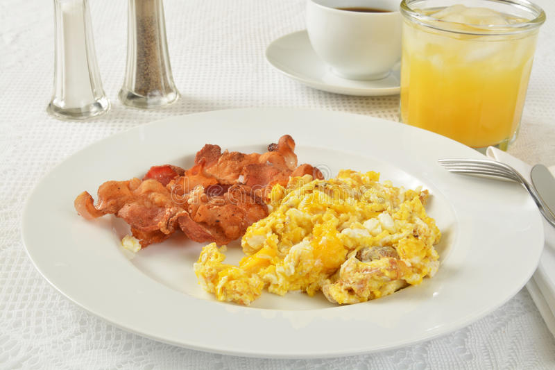 Bacon and eggs. With orange juice and coffee stock images