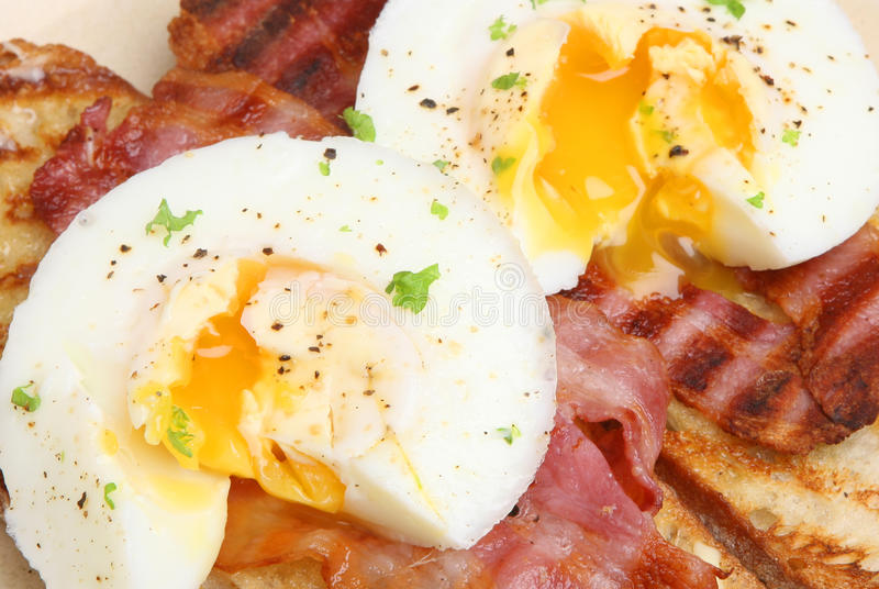 Bacon and Eggs on Toast Breakfast. Bacon and poached eggs on toast royalty free stock photos