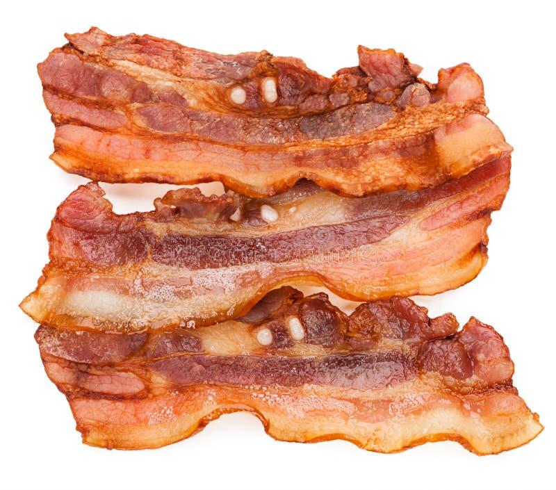 Bacon fresco arrostito isolato su fondo bianco fotografia stock libera da diritti