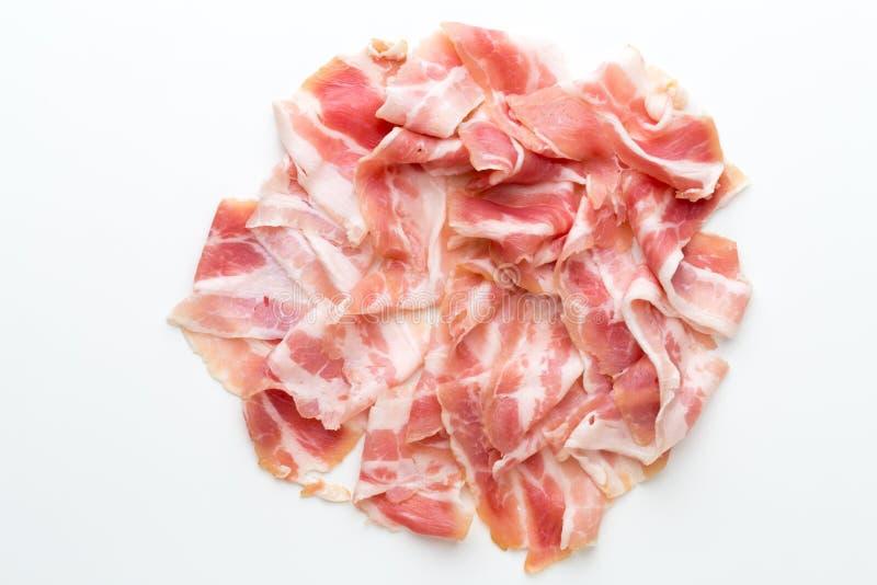 Bacon fresco sui precedenti isolati fotografia stock