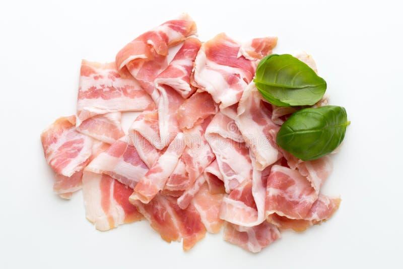 Bacon fresco sui precedenti isolati immagini stock libere da diritti