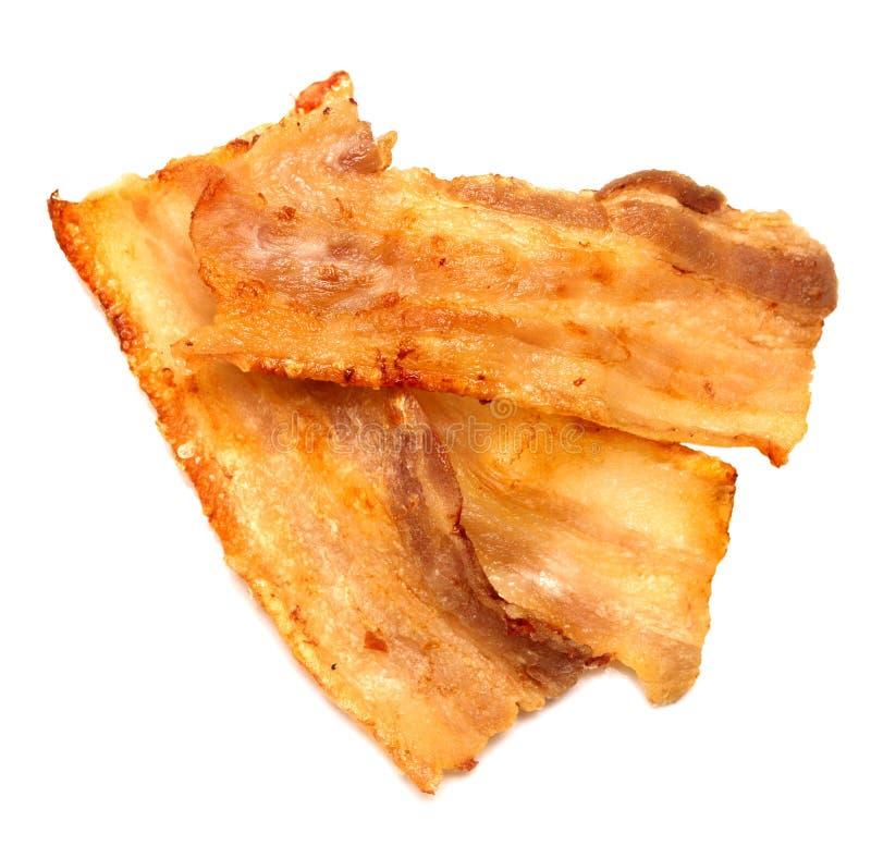 bacon fritado no branco fotografia de stock royalty free