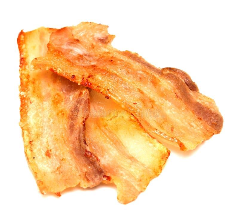 bacon fritado no branco imagem de stock royalty free
