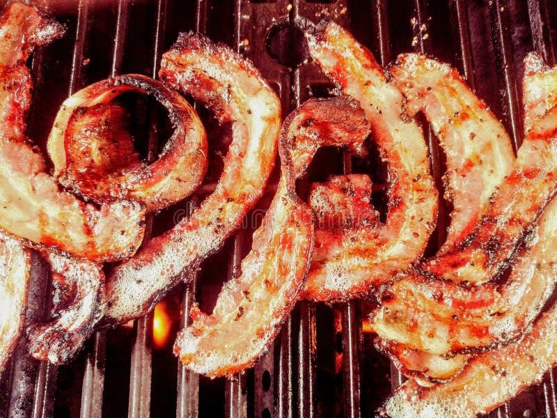 Bacon grosso gourmet da pimenta do corte na grade imagem de stock royalty free