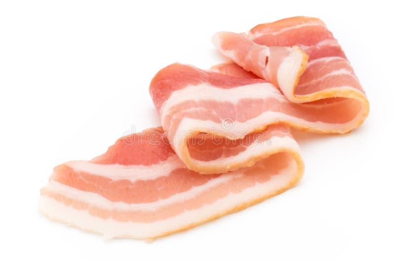 Bacon isolato su fondo bianco Alimento di Delikatese immagine stock