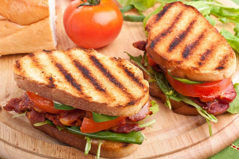 Bacon, lettuce and tomato sandwiches. Grilled Bacon, lettuce and tomato BLT sandwiches stock photos