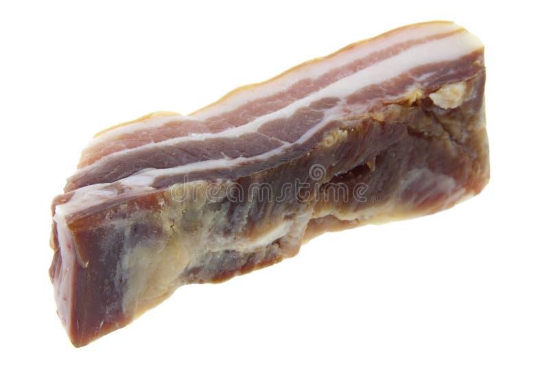 Bacon på white royaltyfri fotografi
