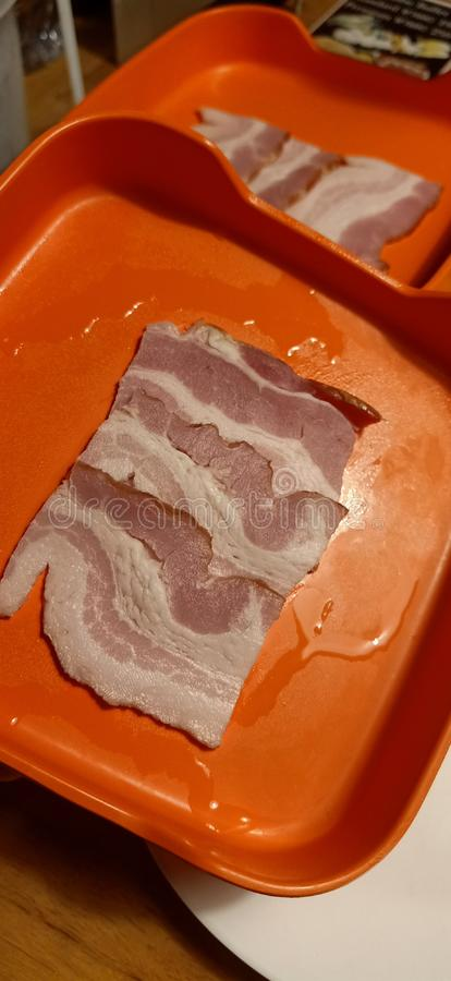 Bacon in plate stock photo