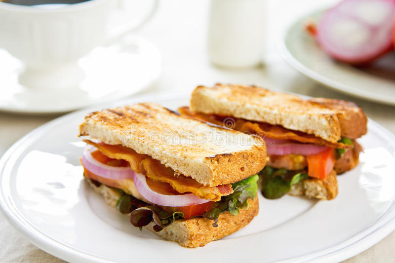 Bacon sandwich. With tomato and lettuce royalty free stock photography