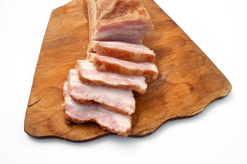 Bacon sliced on white background. pork fat with veins. Bacon sliced on white background. pork fat with veins royalty free stock images