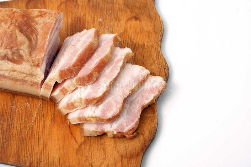 Bacon sliced on white background. pork fat with veins. Bacon sliced on white background. pork fat with veins stock photos