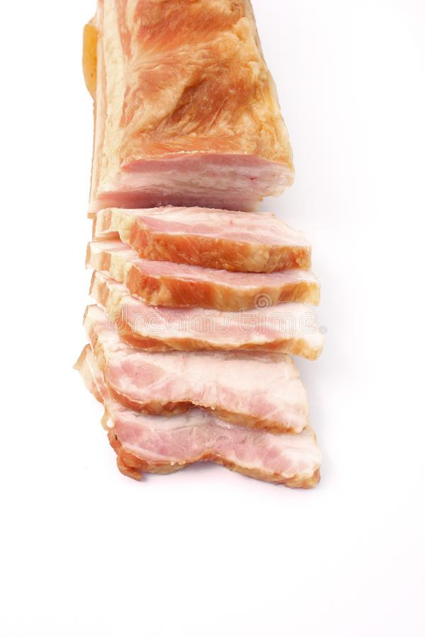 Bacon sliced on white background. pork fat with veins. Bacon sliced on white background. pork fat with veins stock photography