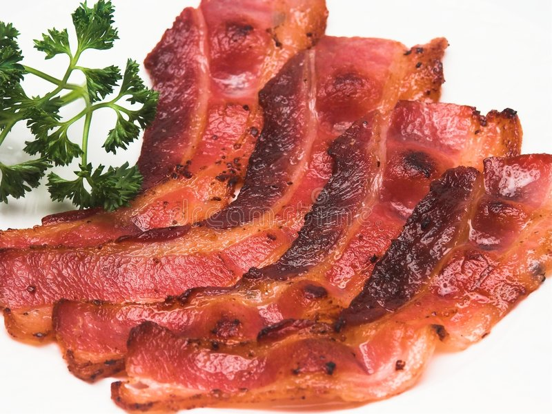 Bacon Strips. A closeup view of some nicely browned bacon strips stock images