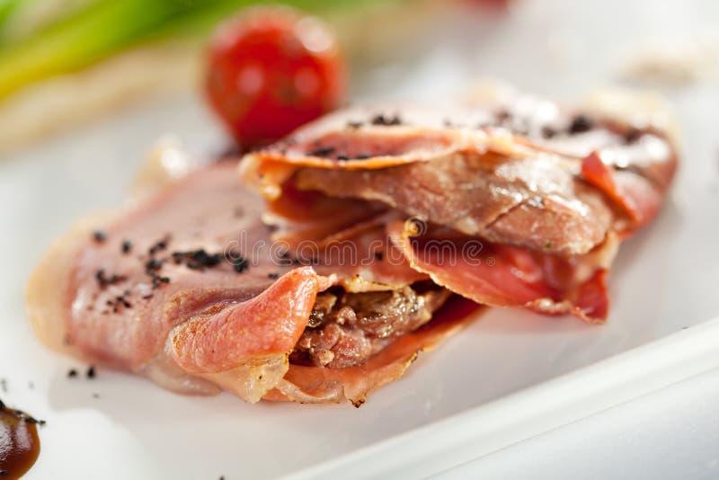 Bacon Verpakt Varkensvlees stock afbeelding