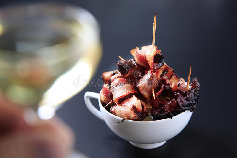 Bacon wrapped prunes royalty free stock photo