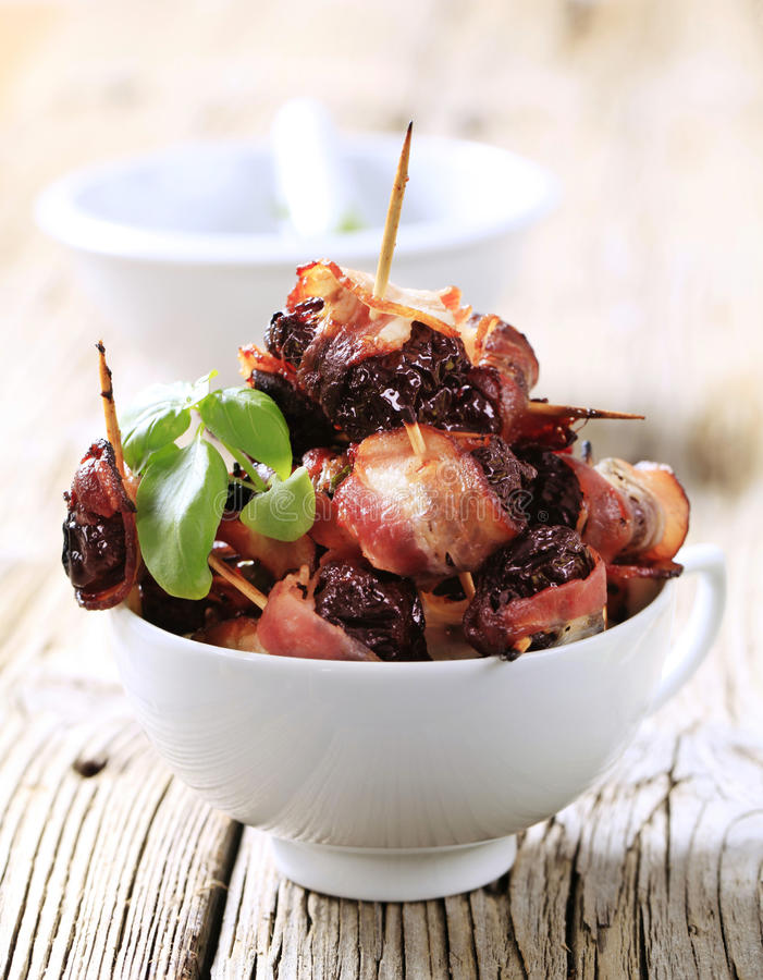 Bacon wrapped prunes royalty free stock image