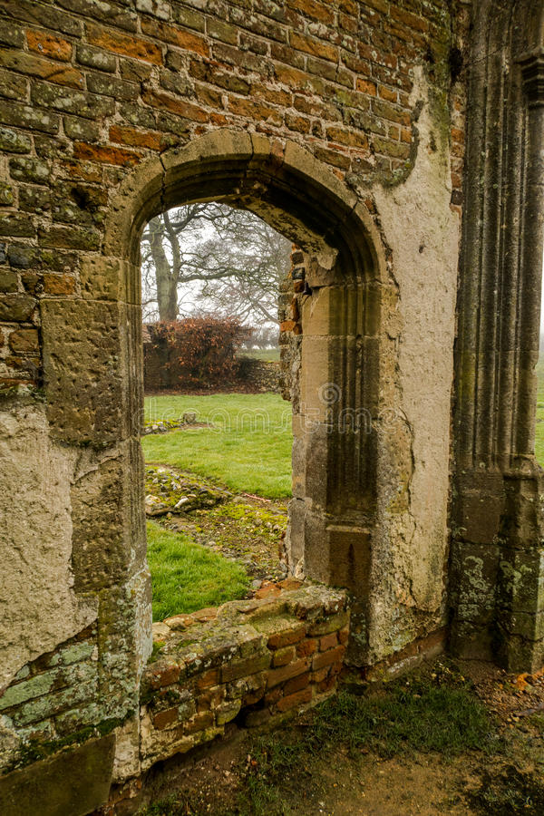 Baconsthorpe Castle, Norfolk, England. An ancient monument in East Anglia, England. A medieval castle on a misty winter`s day royalty free stock image