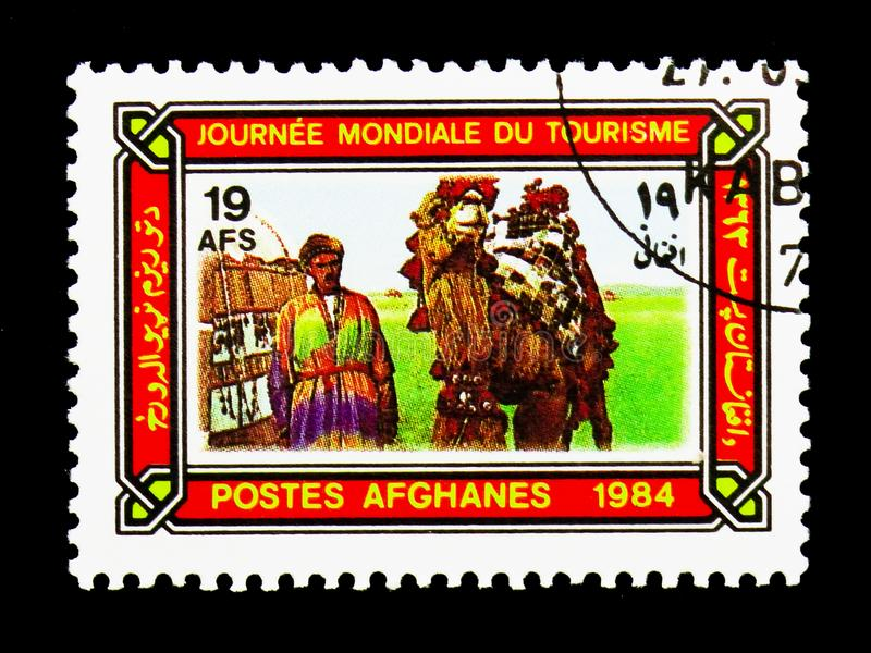 Bactrian Camel (Camelus bactrianus) in ornate caparison, World T. MOSCOW, RUSSIA - DECEMBER 21, 2017: A stamp printed in Afghanistan shows Bactrian Camel ( royalty free stock photography